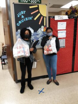 From left to right, Kweli and Mackenzie stand with their TRIO Cares bags for TRIO Cares month.
