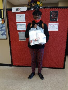Quidarryl stands with his TRIO Cares bag.