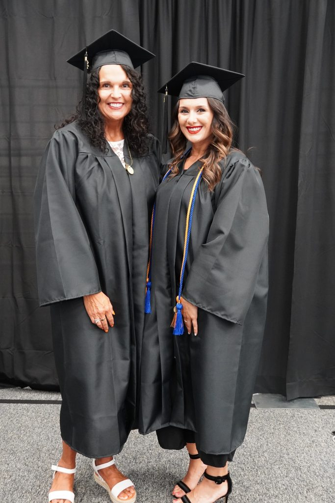 mother and daughter in cap and gown